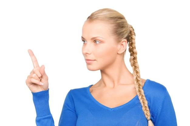 Photo d'une femme d'affaires séduisante pointant son doigt