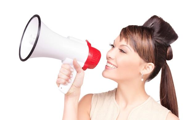 Photo de femme avec mégaphone over white