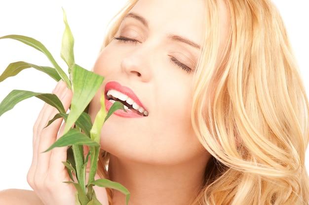 Photo de femme avec sprout over white