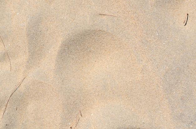 Photo de fond et de texture du sable sur la plage.