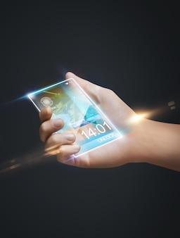 Photo gros plan de la main tenant un téléphone intelligent
