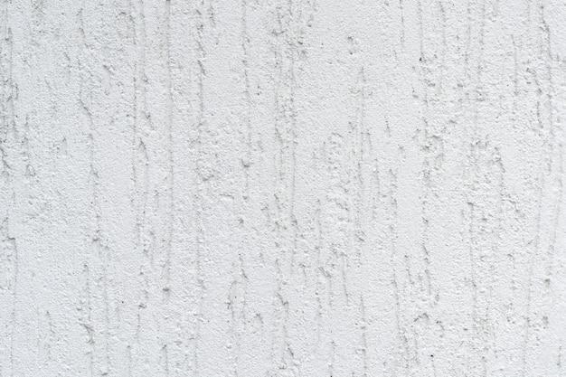 La photo en gros plan de la texture et de l'arrière-plan du stuc blanc brut