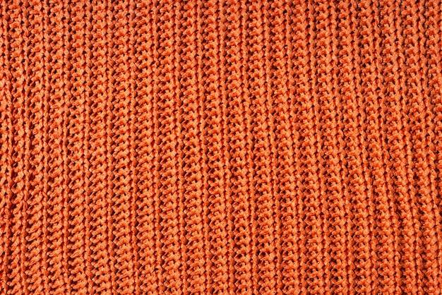 La photo en gros plan de la texture de tissu de laine orange