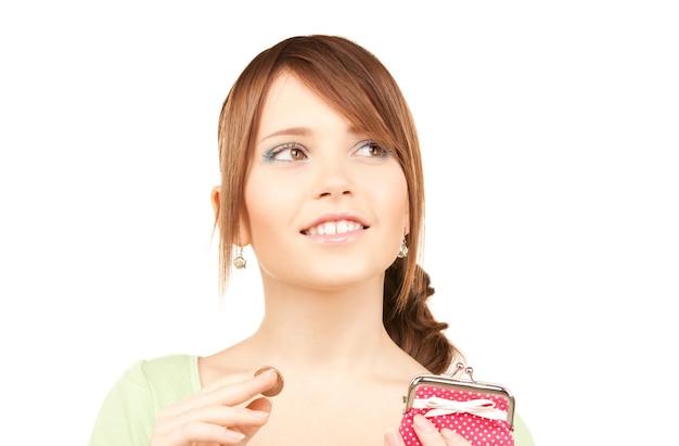 Photo d'une jolie adolescente avec un sac à main et de l'argent