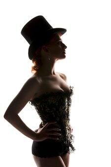Photo de rétroéclairage silhouette de femme sexy en corset