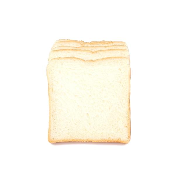 Photo de tranches de pain blanc moelleux sur fond isolé blanc