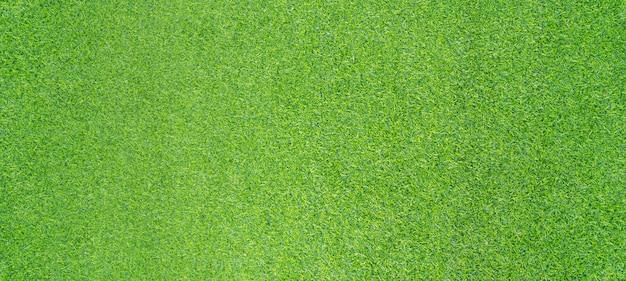 Photo vue de dessus, fond de texture d'herbe verte artificielle