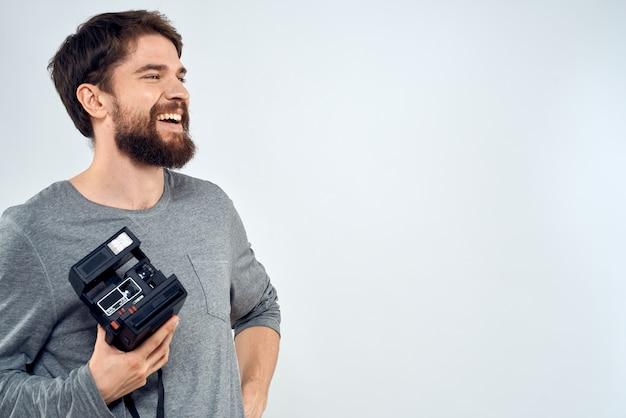 Photographe avec ancien appareil photo rétro