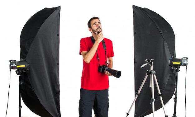 Photographe dans sa pensée de studio
