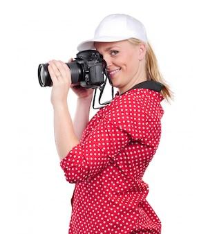 Photographe jolie femme blonde avec son appareil photo, sur blanc