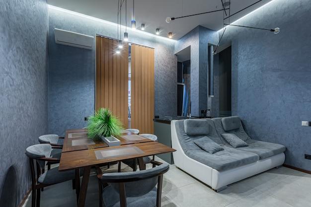 Photographie d'intérieur, cuisine moderne, couleurs sombres de style loft