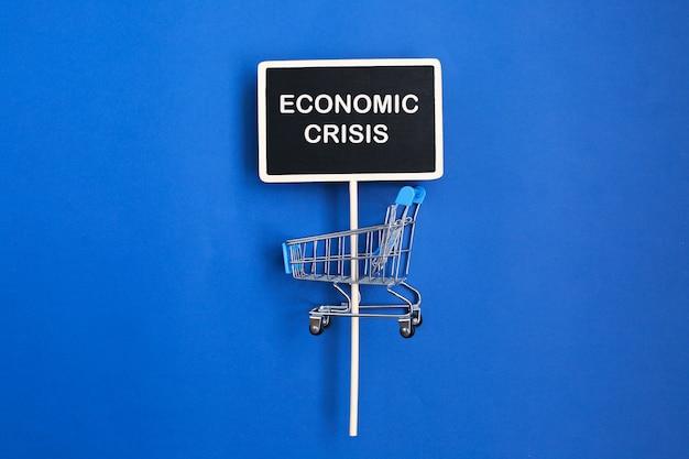 Phrase crise financière et caddie vide