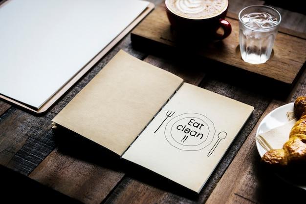 Phrase manger propre sur un cahier