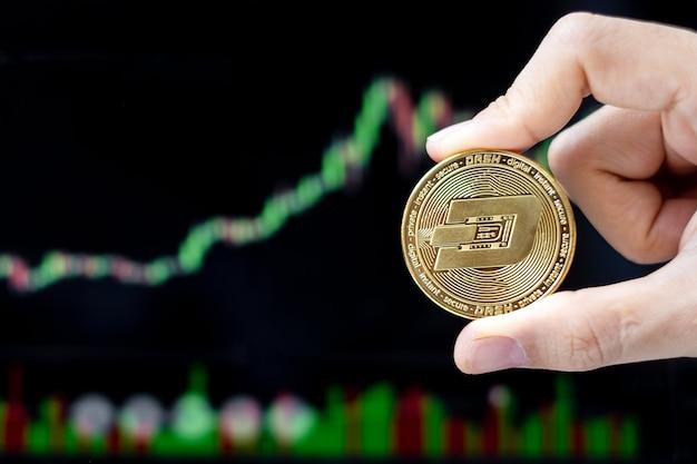 Pièce de crypto-monnaie golden dash avec fond graphique de bougie
