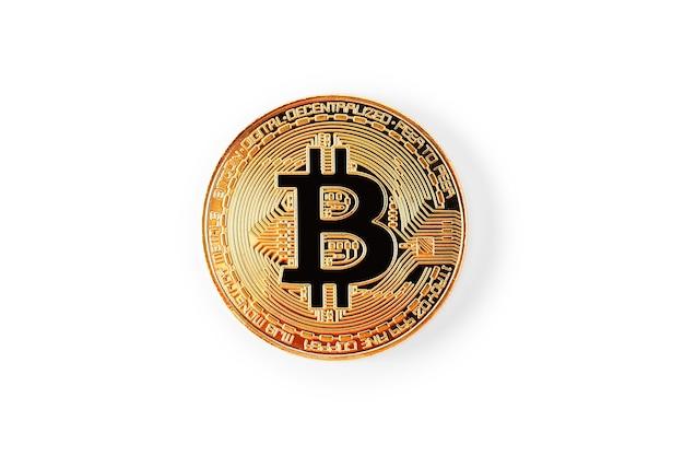 Pièce d'or bitcoin sur table