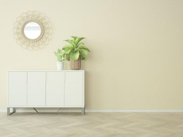 Pièce presque vide avec plante d'intérieur armoire et un miroir sur le mur