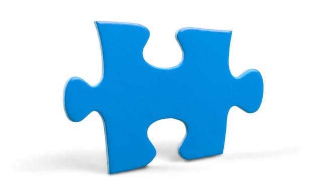 Pièce de puzzle isolée sur concept blanc, stratégie et solution
