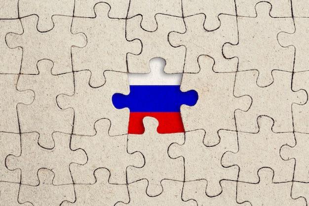 Pièce de puzzle manquante et drapeau russe.