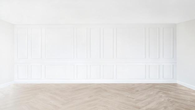 Pièce vide minimale avec mur à motifs blancs