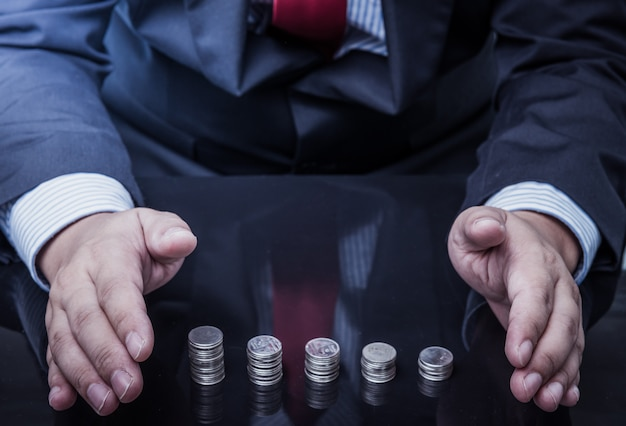 Pièces d'argent protégées de l'homme d'affaires