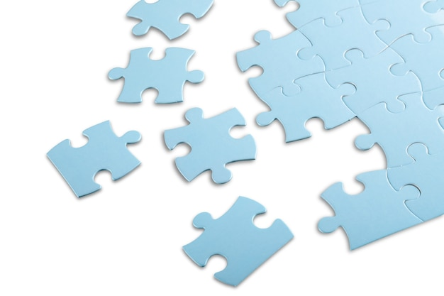 Pièces du puzzle bleu sur fond gris