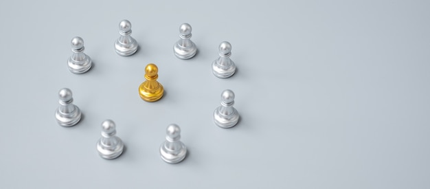 Pièces de pion d'échecs en or ou homme d'affaires leader leader avec cercle d'hommes en argent. concept de leadership, d'entreprise, d'équipe et de travail d'équipe