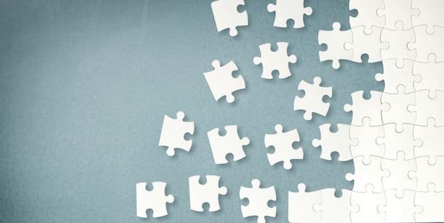 Pièces de puzzle blanches sur fond gris