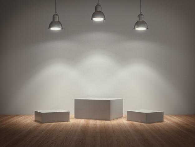 Piédestaux blancs éclairés par une lampe pour exposition de produits dans une pièce en béton