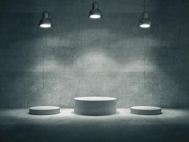 Piédestaux en ciment éclairés par des lampes dans une pièce en béton