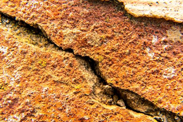 Pierre ancienne grise fissurée bouchent la texture