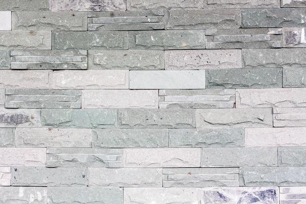 Pierre brique bâton dans le mur comme une texture de fond