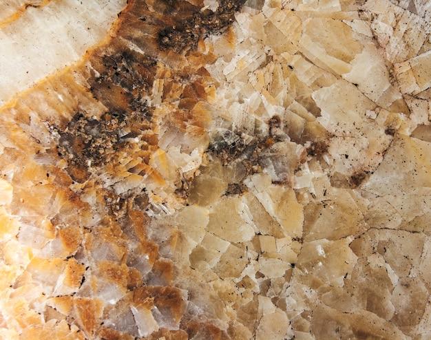 Pierre gemme onyx close-up, texture naturelle fissurée