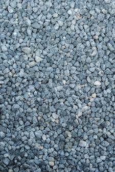 Pierre grise concassée sur le fond de la texture du sol