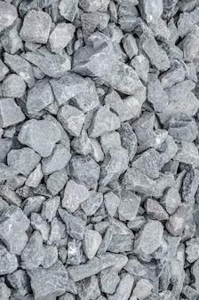 Pierre grise concassée sur la texture du sol
