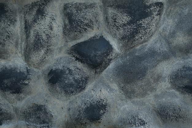 Pierre de mur de bâtiment noir texturé