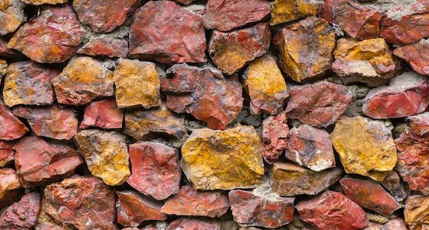 Pierres de galets colorées pour le fond de texture de mur