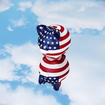 Piggy america mis sur le miroir de réflexion avec le ciel.