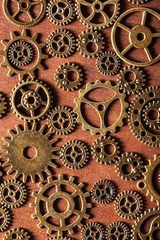 Pignons mécaniques steampunk engrenages roues sur fond de bois