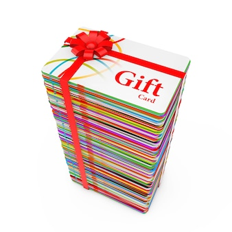 Pile de cartes-cadeaux en plastique multicolores avec ruban rouge et noeud sur fond blanc. rendu 3d
