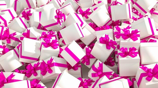 Pile de coffrets cadeaux blancs avec des rubans roses