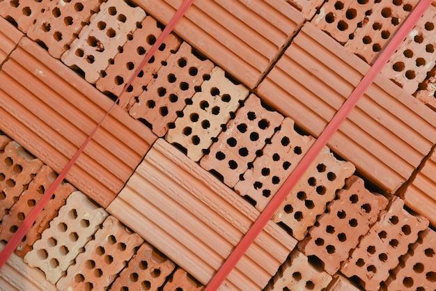 Pile de nouveau fond de pack de briques rouges