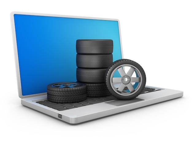 Une pile de pneus de voiture et de roues sur un ordinateur portable. rendu 3d