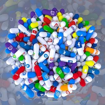 Des pilules de différents types et tailles dans une bouteille portant le logo des réseaux sociaux les plus célèbres.
