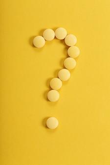 Pilules en forme de point d'interrogation