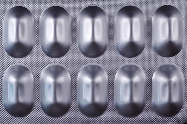 Pilules médecine blister fond noir