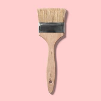 Pinceau isolé pour peindre sur un fond rose. adapté à votre élément de conception.