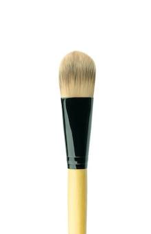 Pinceau de maquillage isolé sur blanc