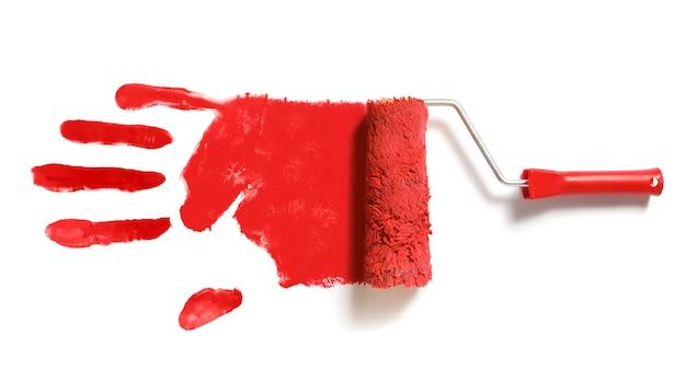 Pinceau rouleau à peinture avec empreinte de main droite rouge isolé