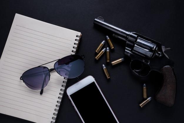 Pistolet sur fond noir