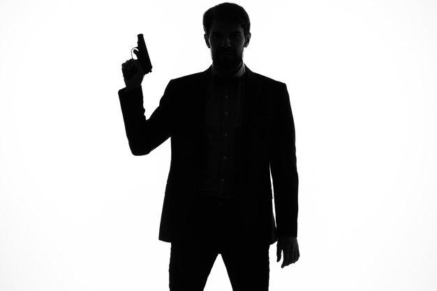 Pistolet d'hommes d'affaires dans les mains de l'arrière-plan isolé silhouette émotions